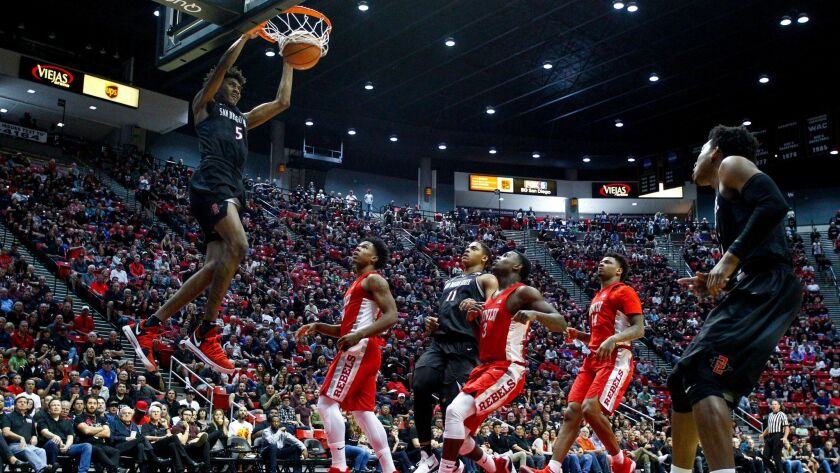 SDSU forward Jalen McDaniels dunks on an alley-oop from Devin Watson in the first half against UNLV.