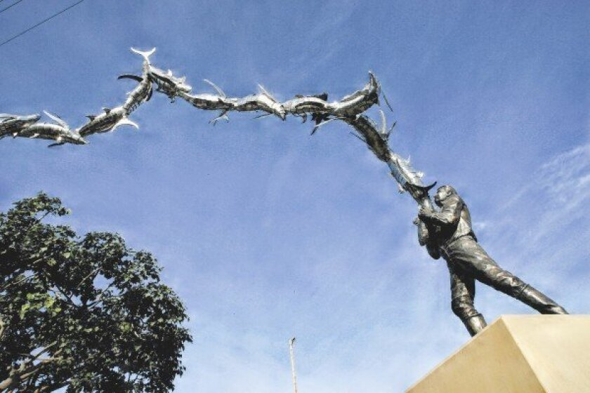 The fish look as if they are flying in the sculptural homage to the history of Tuna Cannery Workers.