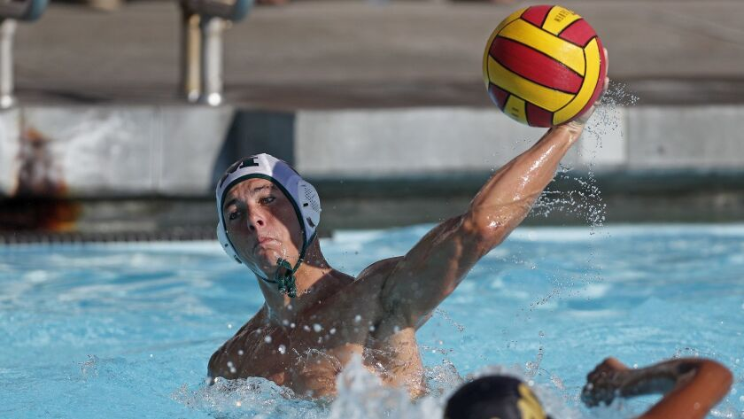 Costa Mesa High's Caedmon Fisher scores against Estancia during the first half in an Orange Coast Le
