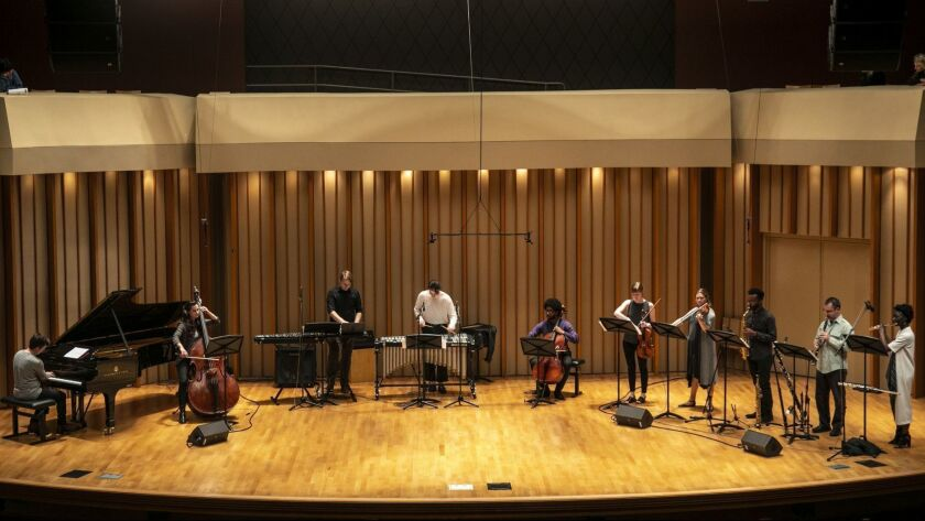 Julius Eastman's 'Femenine' is performed at Monday Evening Concerts by an ensemble including artistic director Jonathan Hepfer on vibraphone, center, and cellist Seth Parker Woods, to his right, at Zipper Concert Hall