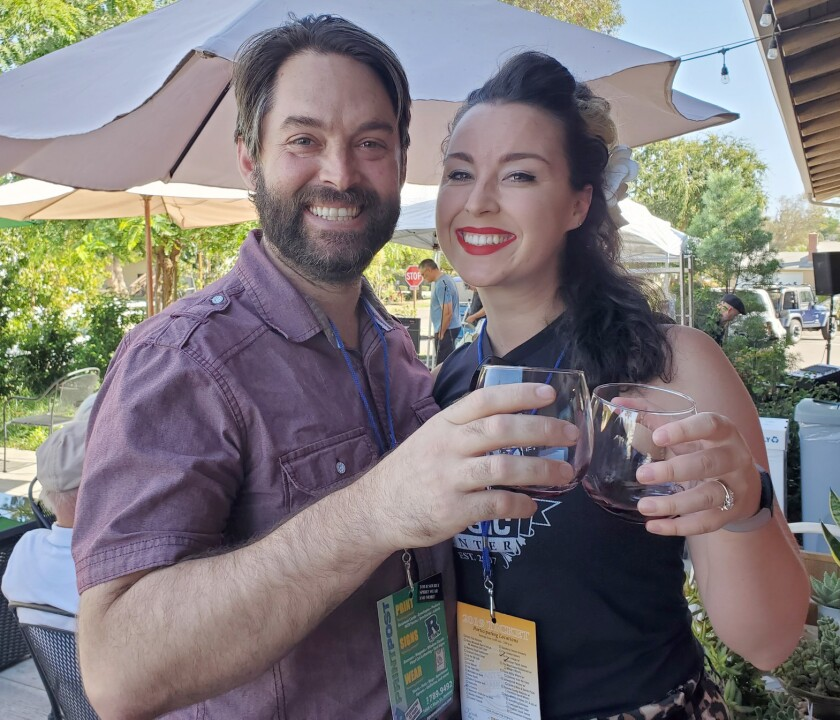 Jon and Cathryn Hasz make a toast at Ramona Family Naturals Market during the 2019 Taste of Ramona event.