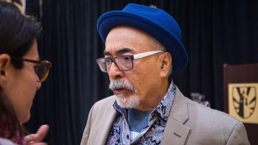 Poet Laureate Juan Felipe Herrera talks with an attendee of his speech at The Bishop's School in La Jolla.