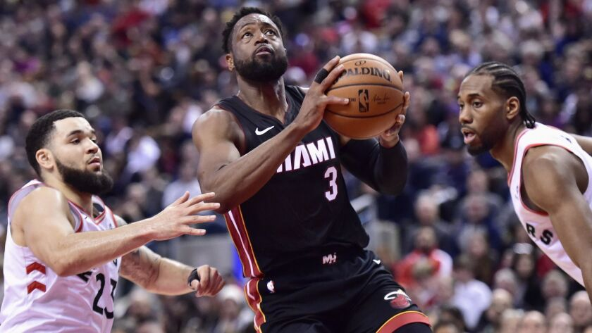Miami Heat guard Dwyane Wade (3) drives to net past Toronto Raptors guard Fred VanVleet (23) and for