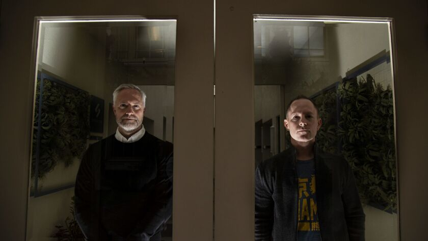 """Brian, left, and Mark Gunn, the writers behind """"Brightburn,"""" a superhero horror film that imagines what might have happened if Superman fell to Earth but was evil, are shown in Culver City."""