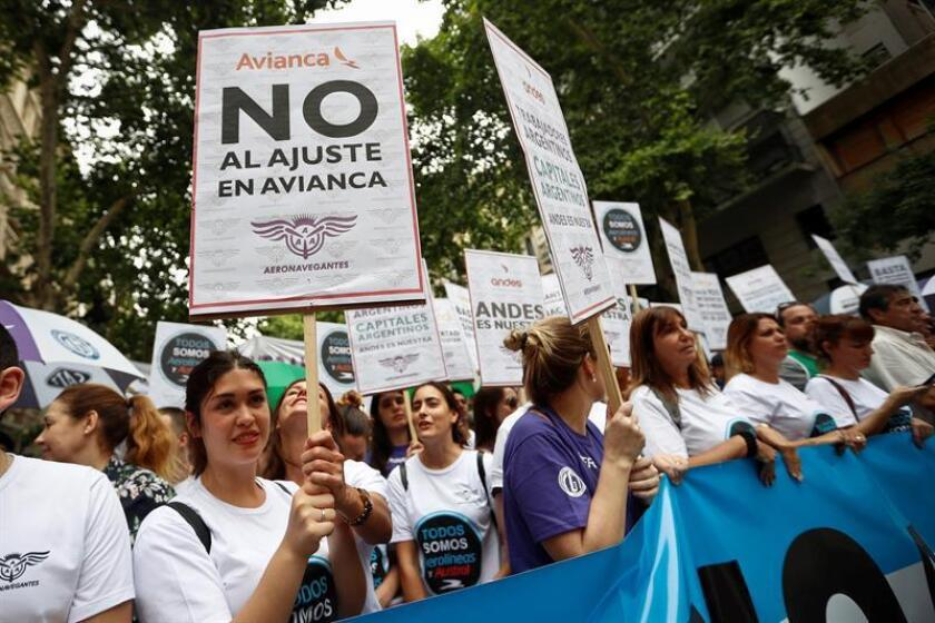 Workers in the aeronautical sector protest to demand improvements in labor and salary and against the precariousness of the sector, in Buenos Aires, Argentina, Dec. 27, 2018. The protest was called by the Argentine Association of Aeronavegantes (AAA) to the 'job insecurity' that the sector is going through, the dismissals, and the union persecution, explained unionist Juan Pablo Brey. EPA-EFE/Juan Ignacio Roncoroni
