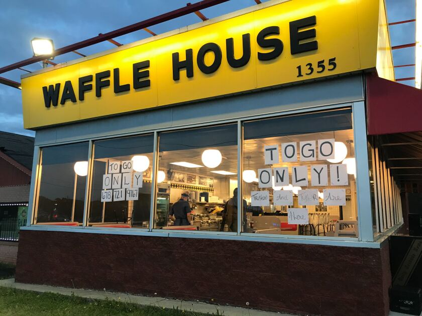 A Waffle House in Cartersville, Ga., is serving only takeout after the mayor signed a countywide emergency joint resolution that closed all bars, dine-in restaurants and theaters.