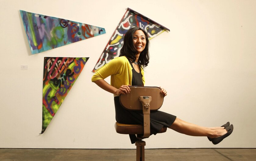 Graphic artist Suzanne Ito takes a spin through the Space 4 Art gallery in the East Village. Works  by students from the AIGA LINK program, where Ito is a mentor, will be on display at Space 4 Art on April 1.
