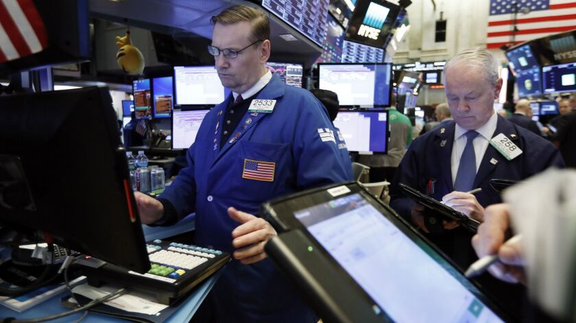 Specialist Patrick King, left, on the floor of the New York Stock Exchange.