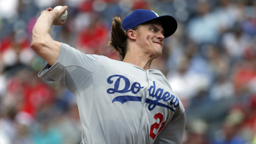Dodgers starter Zack Greinke delivers a pitch during the third inning against the Washington Nationals on Sunday.