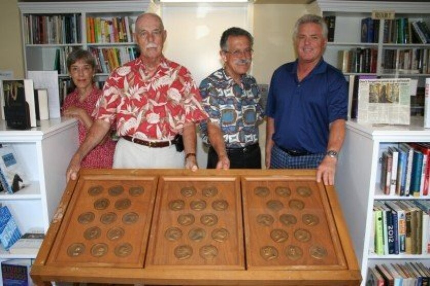 Commemorative presidential coins discovered at the RSF Library were purchased to travel the country with the Spirit of Liberty Foundation.  (L-R) RSF Library Guild members Susan Appleby and Harry Bord, RSF Library Guild President Art Yayanos, and Michael Rainey, the executive vice president of the