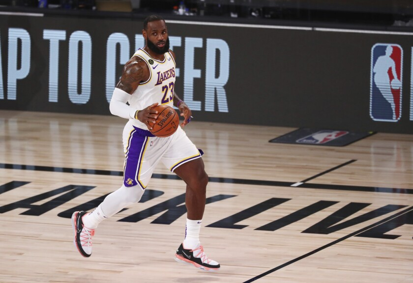 Lakers forward LeBron James brings the ball upcourt against the Utah Jazz on Monday in Orlando, Fla.