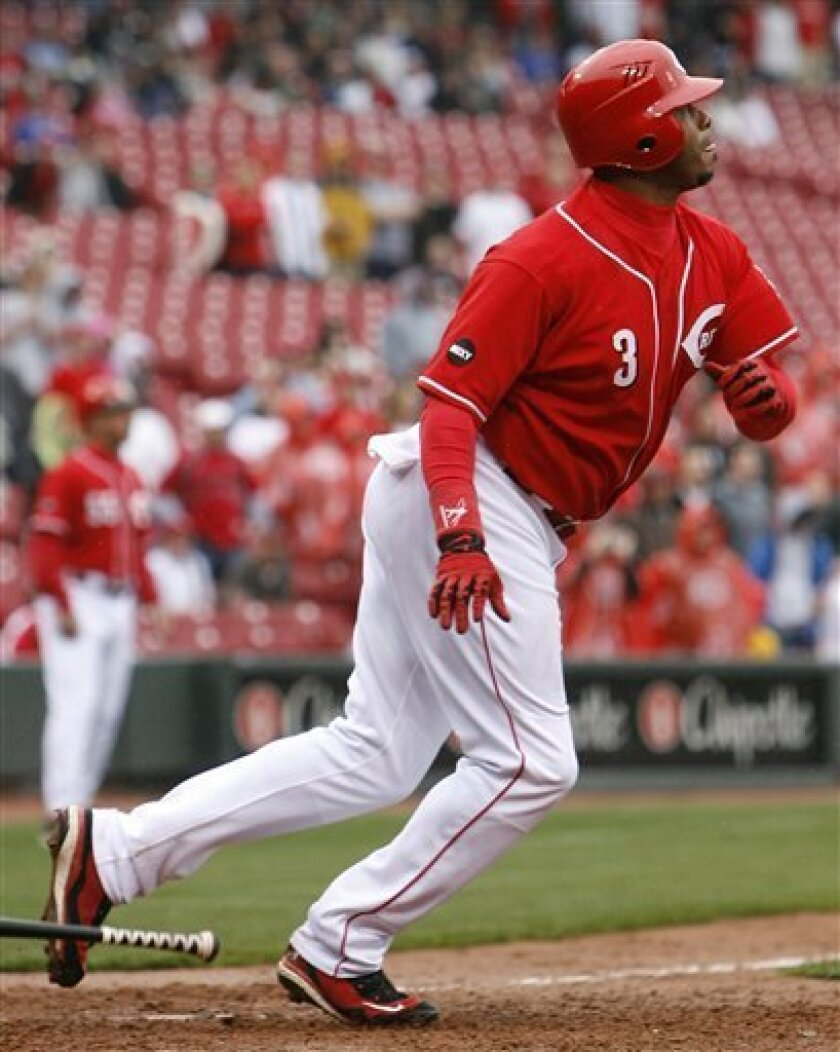 Cincinnati Reds' Ken Griffey Jr. hits to drive in the winning run in the bottom of the 11th inning of a baseball game against the Milwaukee Brewers, Sunday, April 20, 2008, in Cincinnati. (AP Photo/David Kohl)