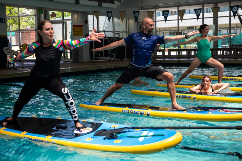 Eric Vandendriessche leads his Aqua Stand Up paddleboard class
