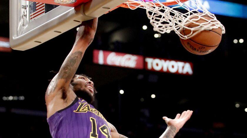 LOS ANGELES, CALIF. - NOV. 30, 2018. Lakers forward Brandon Ingram throws down a dunk against the