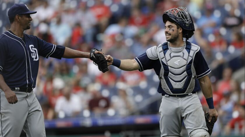 San Diego Padres' Tyson Ross, left, and Austin Hedges celebrate during the first baseball game in a