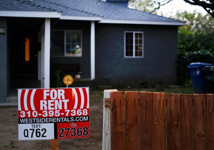 FILE - This Friday, Feb. 27, 2015 file photo shows a sign advertising a house for rent in Los Angeles. Real estate data firm Zillow releases its August data on rental prices around the country on Tuesday, Sept. 22, 2015. (AP Photo/Richard Vogel, File)
