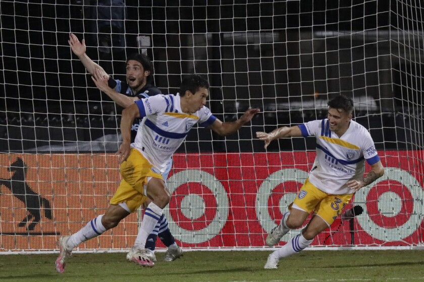 San Jose Earthquakes midfielder Shea Salinas, left foreground, after a goal at an MLS match Wednesday in Kissimmee, Fla.