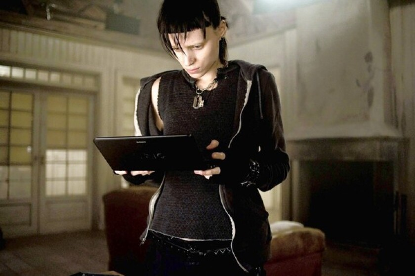 "Fleece hoodies and thermal wear lend street cred to ""Girl With a Dragon Tattoo's"" lead character Lisbeth Salander, played by Rooney Mara."