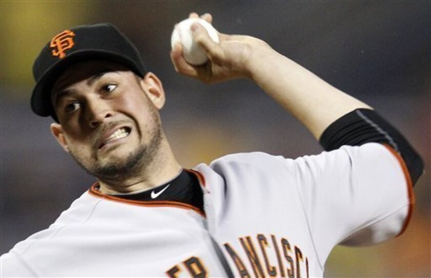 San Francisco Giants pitcher Jonathan Sanchez throws in the first inning during a baseball game against the Pittsburgh Pirates in Pittsburgh, Friday, June 4, 2010. (AP Photo/Gene J. Puskar)