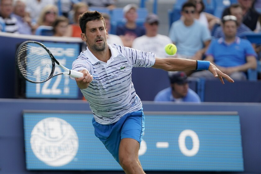 Novak Djokovic hits a forehand during his match against Daniil Medvedev.