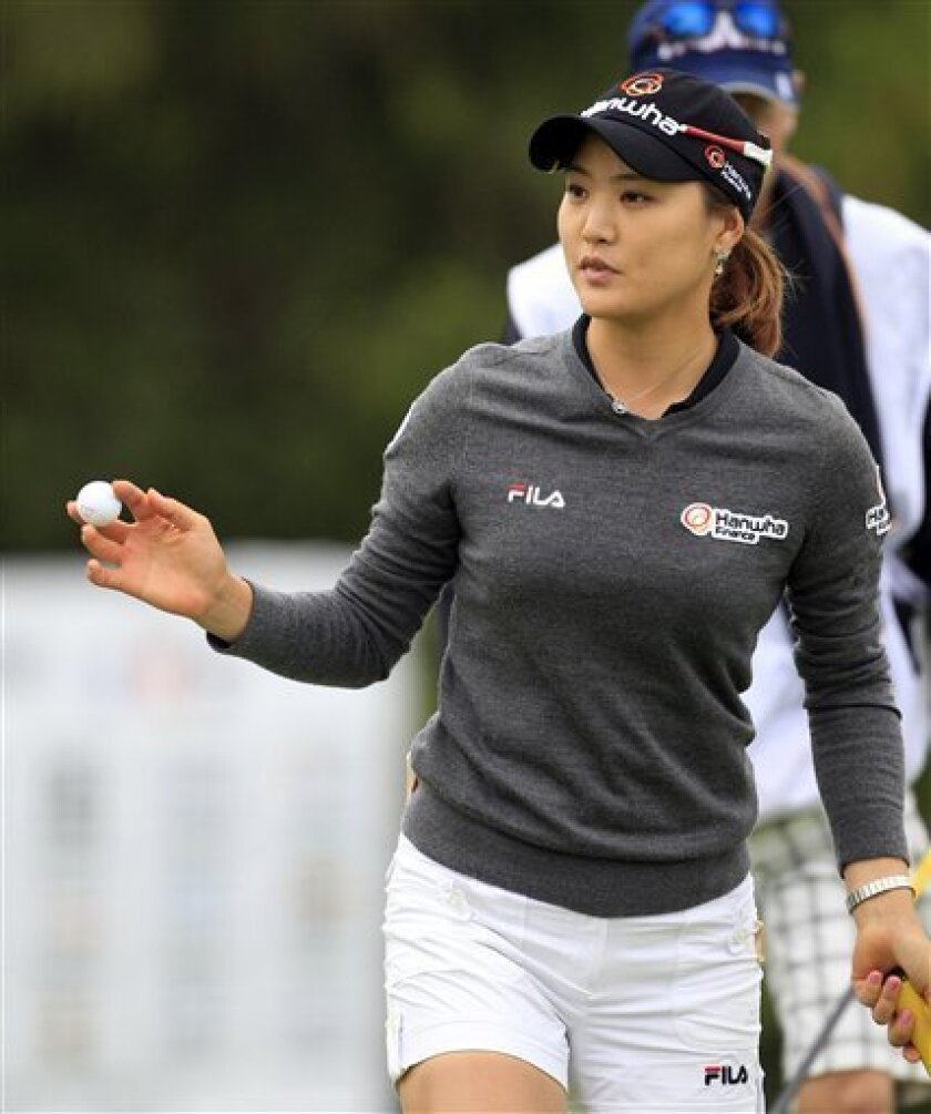 So Yeon Ryu of South Korea acknowledges the crowd on the 8th green during the second round of the Jamie Farr Toledo Classic at the Highland Meadows Golf Club in Sylvania, Ohio, Friday, Aug. 10, 2012. (AP Photo/Carlos Osorio)