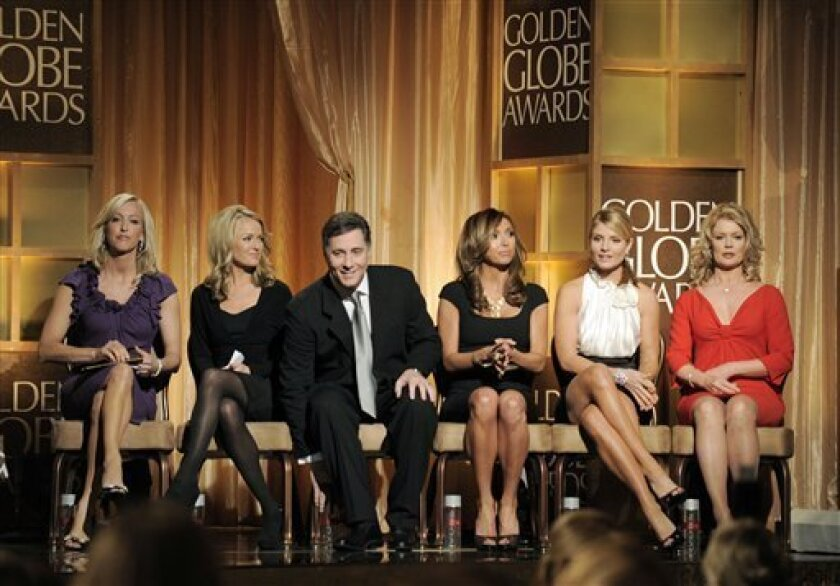 ** The six presenters of the 65th annual Golden Globe awards sit onstage at the start of the show at at the Beverly Hilton Hotel in Beverly Hills, Calif., in this Sunday, Jan. 13, 2008 file photo.  From left, are Lara Spencer of Insider; Brooke Anderson Showbiz Tonight, CNN; Jim Moret, Inside Editi
