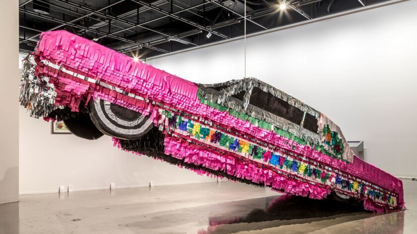 A piñata lowrider by Justin Favela at the Petersen Automotive Museum — inspired by one of the most f