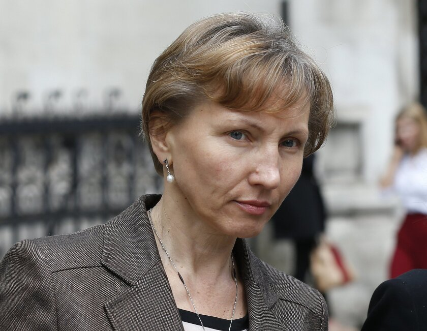 Marina Litvinenko, the widow of former Russian intelligence officer Alexander Litvinenko leaves the Royal Courts of Justice in London, Thursday, July 30, 2015. Closing statements for the Litvinenko inquiry started Thursday at the court, Litvinenko died in London in 2006 after drinking tea laced with radioactive polonium. (AP Photo/Frank Augstein)