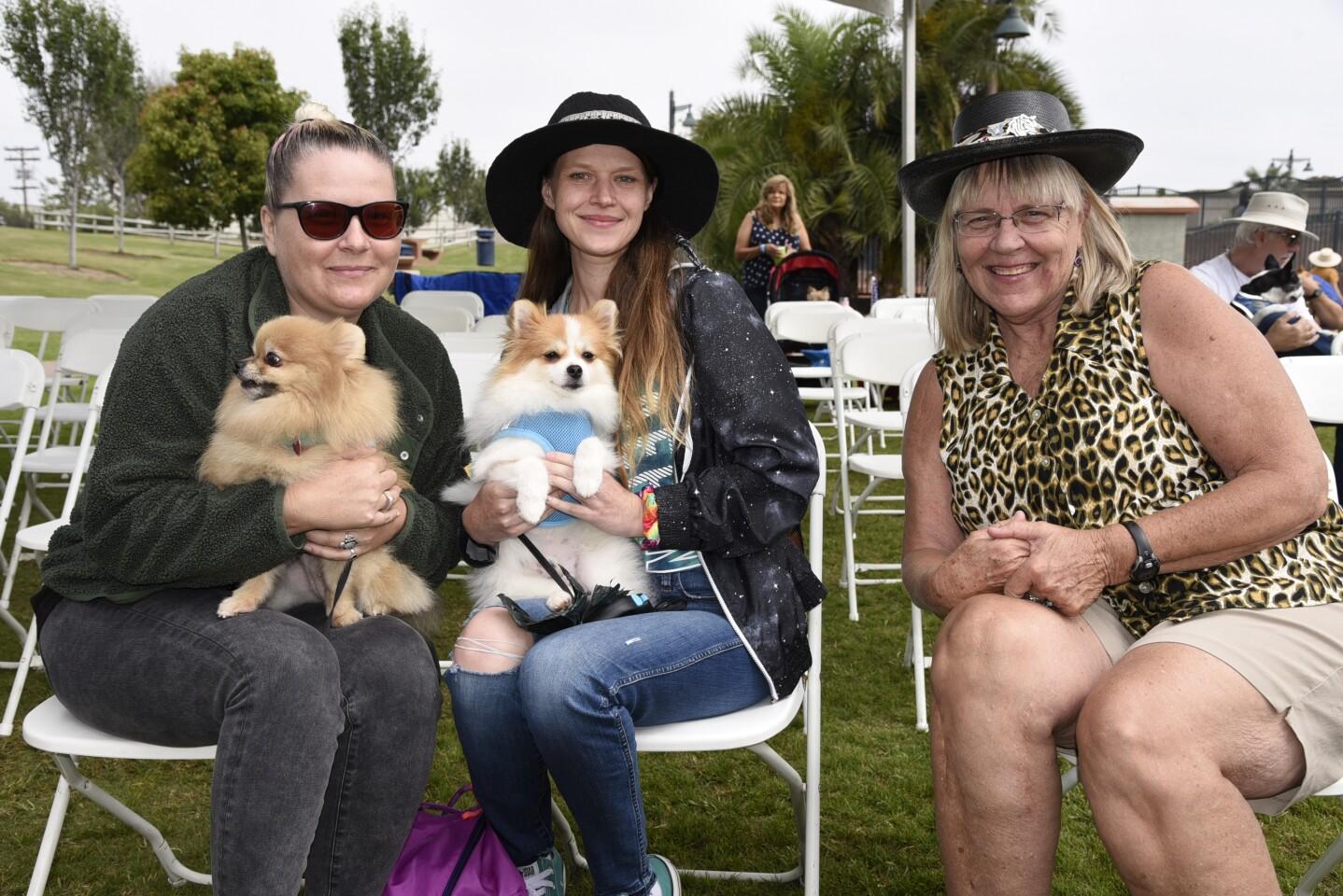Bridget Dobiesz with 'Nala', Ginger Dobiesz with 'Mogwai', Catherine Dobiesz