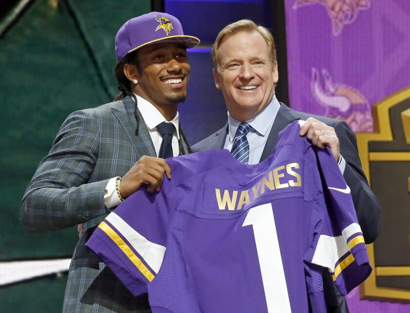Michigan State defensive back Trae Waynes poses for photos with NFL commissioner Roger Goodell after being selected by the Minnesota Vikings as the 11th pick in the first round of the 2015 NFL Draft,  Thursday, April 30, 2015, in Chicago. (AP Photo/Charles Rex Arbogast)