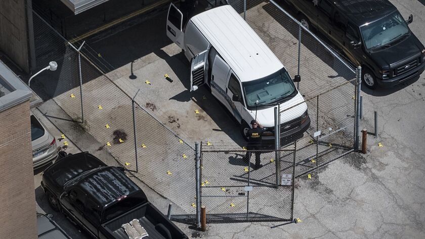 Evidence markers dot the pavement just outside the Wyandotte County courthouse, Friday, June 16, 201