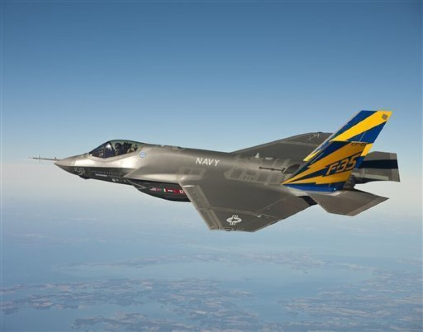 In this Feb. 11, 2011 file photo released by the U.S. Navy, a variant of the F-35 Joint Strike Fighter, the F-35C, conducts a test flight over the Chesapeake Bay. In a deal that could be worth billions of dollars and determine one of the primary fighter jets in Asia for decades to come, European aircraft makers are trying to convince Japan to do something it has never done before _ snub America. (AP Photo/U.S. Navy, Lockheed Martin, FILE)