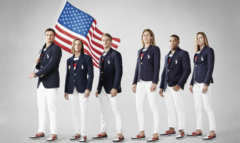 Members of the U.S. Olympic team model the Polo Ralph Lauren opening ceremony uniforms