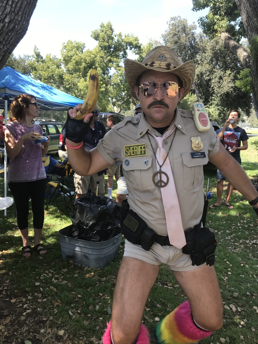 """The faux law, a tailgate party crasher dressed for """"Reno 911!"""""""