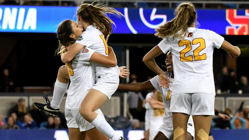 USC players celebrate after defeating Georgetown on Friday night in a College Cup semifinal.