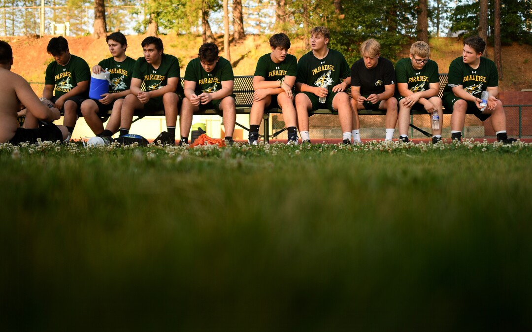 Paradise football players take a break during a team training camp session.