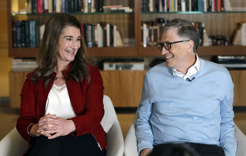 FILE - In this Feb. 1, 2019, file photo, Bill and Melinda Gates smile at each other during an interview in Kirkland, Wash.