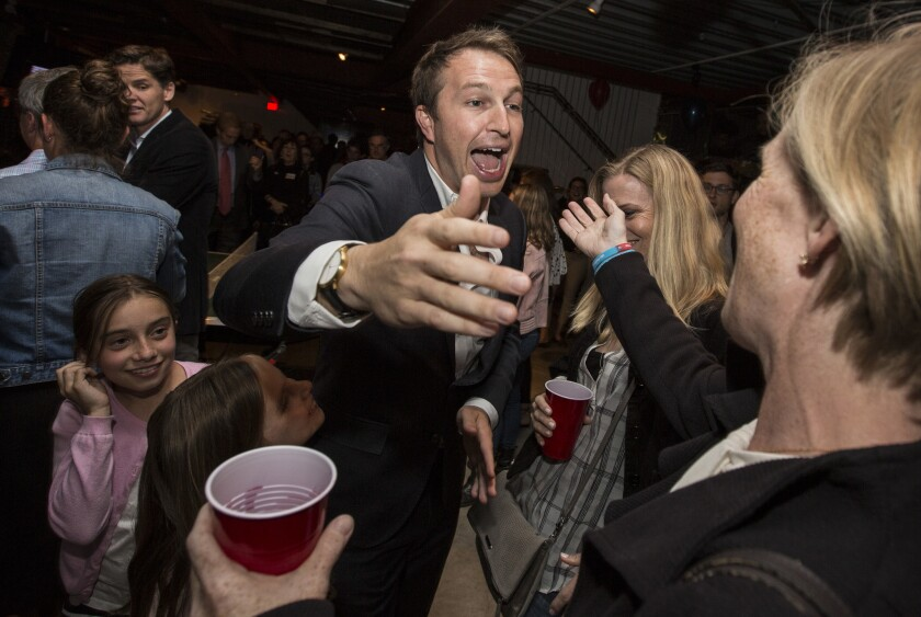 L.A. Unified School Board candidate Nick Melvoin is congratulated by supporters Tuesday night.