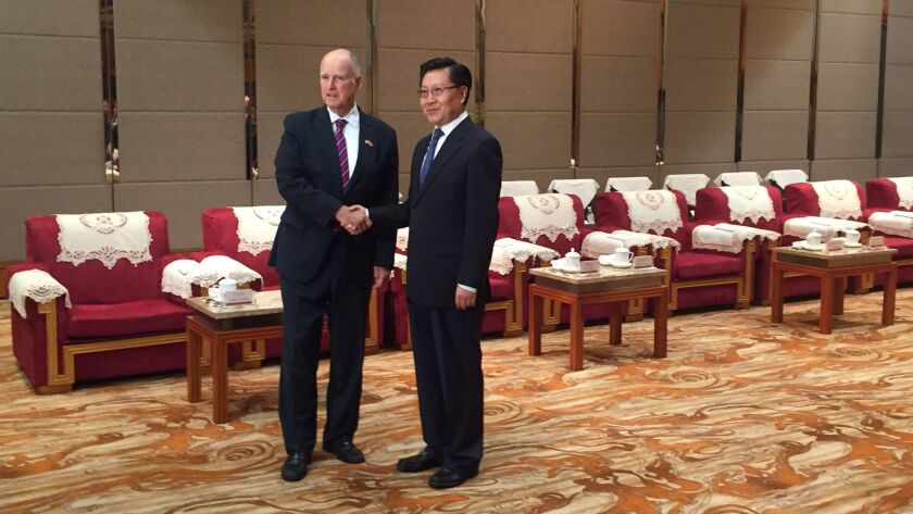 Gov. Jerry Brown meets with Sichuan Communist Party Secretary Wang Dongming in Chengdu.