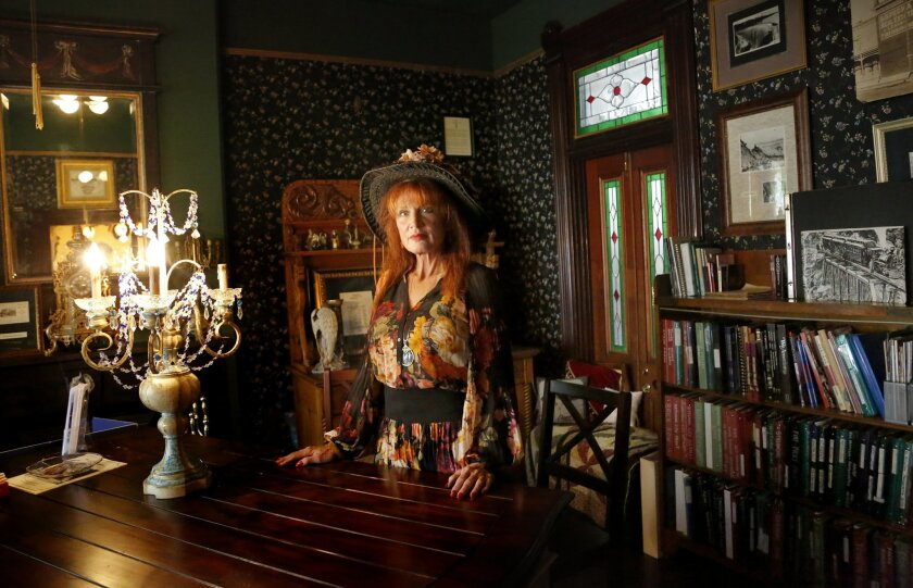 Janice Martinelli, president of the National City Historical Society, stands in the newly opened archive room on the city's Brick Row. Martinelli has spent decades advocating for the preservation of the city's history.