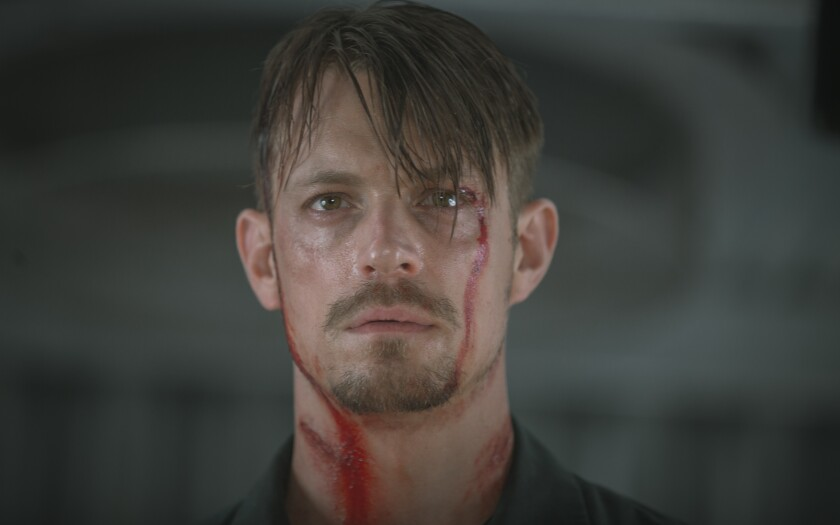 """Snitches, indeed, get stitches: Joel Kinnaman plays a good man in a bad situation in """"The Informer."""""""