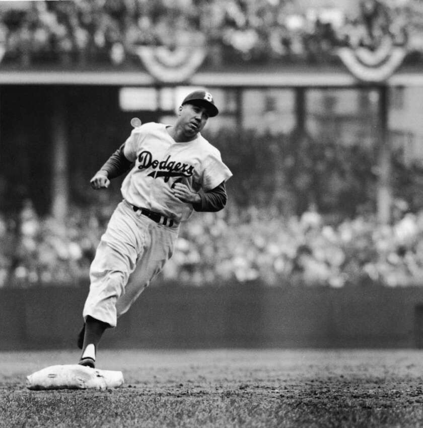 Duke Snider rounds the bases after homering in 1956.