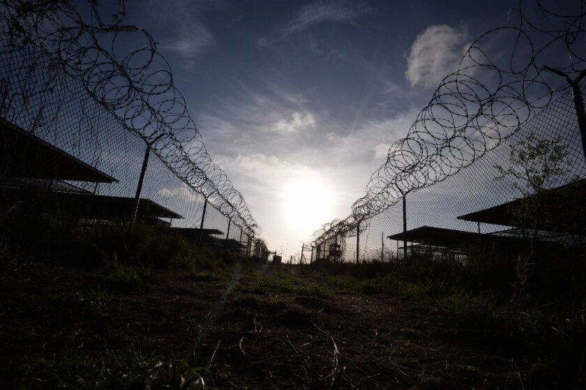 The razor wire-topped fence at the now-closed Camp X-Ray detention facility at the U.S. naval base at Guantanamo Bay, Cuba.