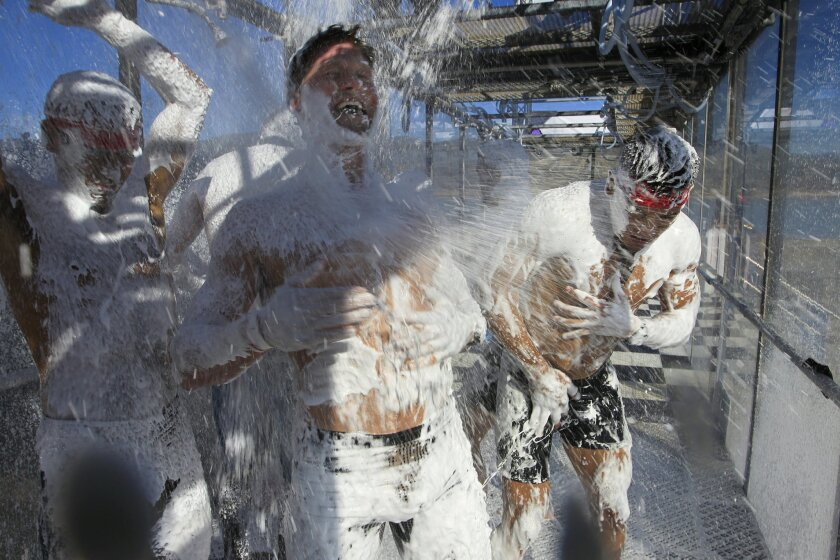 Hunter McIntyre from Mailbu, along with other participants in the Spartan Race 2015 at the Vail Lake Resort in Temecula, get a good soaking of Dr. Bronner's peppermint flavored foaming magic soap in Dr. Bronner's All-One Magic Foam Experience at the end of the race.