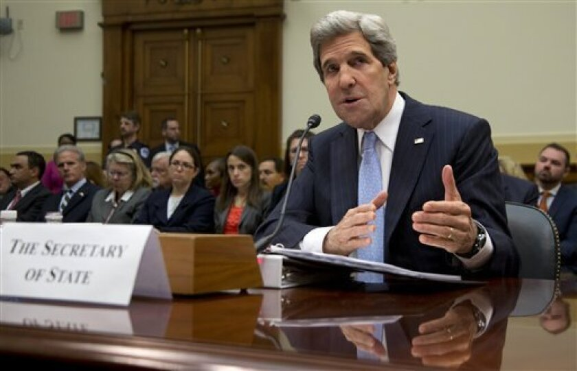 Secretary of State John Kerry testifies on Capitol Hill in Washington, Wednesday, April 17, 2013, before the House Foreign Affairs Committee hearing on the State Department's fiscal 2014 foreign affairs budget.  (AP Photo/Carolyn Kaster)
