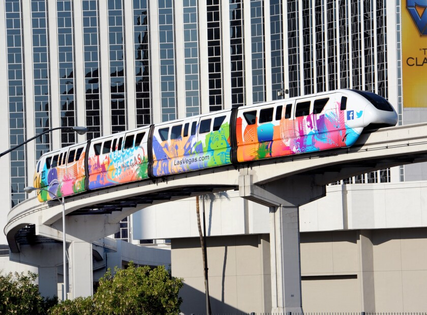A colorful monorail train travels along Paradise Road past the LVH resort, recently renamed the Westgate Las Vegas. The monorail celebrates a decade of service on Saturday with events at all seven stations.