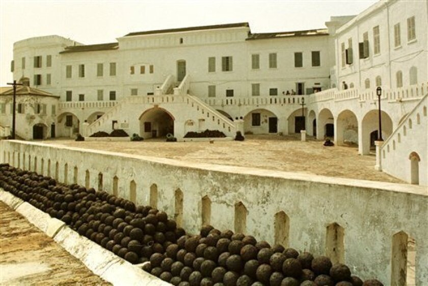 File - A general view of a slave fortress in Cape Coast, Ghana is shown in this Dec. 6, 1996 file photo. Obama planned to tour the castle later Saturday July 11, 2009, a seaside fortress converted to the slave trade by the British in the 17th century. In its dungeons, thousands of shackled Africans huddled in squalor before being herded onto ships bound for America. (AP Photo/Clement N'Taye, File)