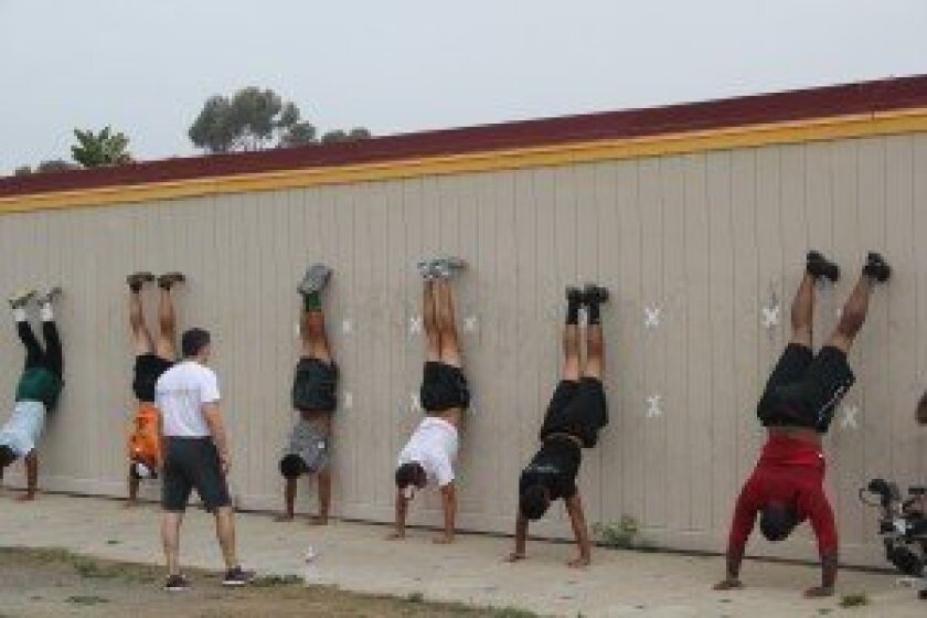 A group does headstands.