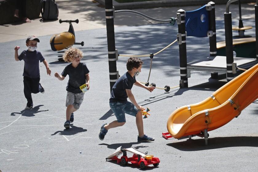 Children run at a playground