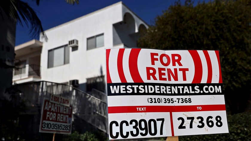 """A """"for rent"""" sign is posted in front of an apartment building in Los Angeles."""